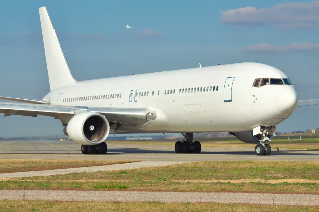 Large passenger jet taxiing to the runway in the airport